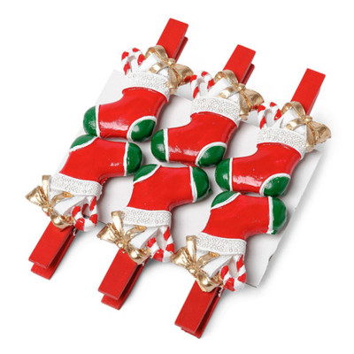 Pince botte de Noël rouge en résine.